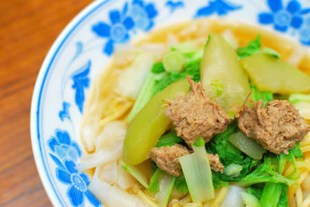 sumptuous: Sumptuous looking Chinese style vegetarian white noodles with mock meat and vegetables. Suitable for concepts such as diet and nutrition, healthy eating and healthy lifestyle, and food and beverage. Stock Photo