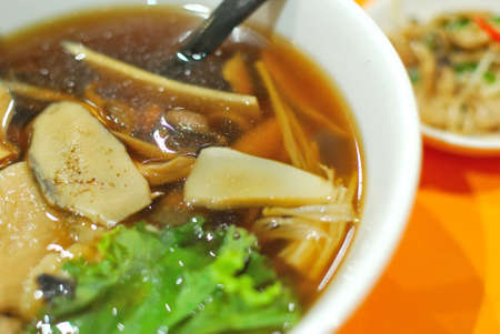 Sumptuous and healthy looking Chinese vegetarian mushroom noodles. Suitable for concepts such as diet and nutrition, healthy eating and healthy lifestyle, and food and beverage. photo