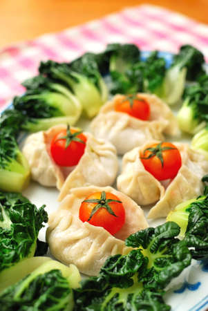sumptuous: Sumptuous looking Chinese style uncooked vegetarian dumplings and vegetables. Suitable for concepts such as diet and nutrition, healthy eating and healthy lifestyle, and food and beverage.