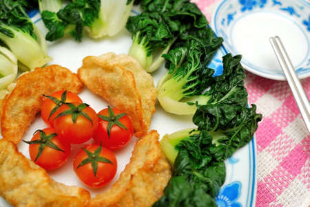 sumptuous: Sumptuous looking Chinese style fried vegetarian dumplings and vegetables. Suitable for concepts such as diet and nutrition, healthy eating and healthy lifestyle, and food and beverage. Stock Photo