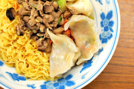 sumptuous: Sumptuous looking Chinese style vegetarian noodles with mock meat and dumplings. Suitable for concepts such as diet and nutrition, healthy eating and healthy lifestyle, and food and beverage.