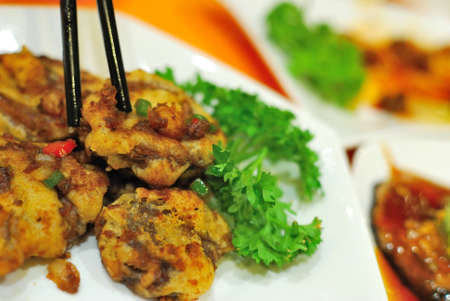 sumptuous: Sumptuous looking Chinese vegetarian mock meat made from fried mushrooms. Suitable for concepts such as diet and nutrition, healthy eating and healthy lifestyle, and food and beverage. Stock Photo