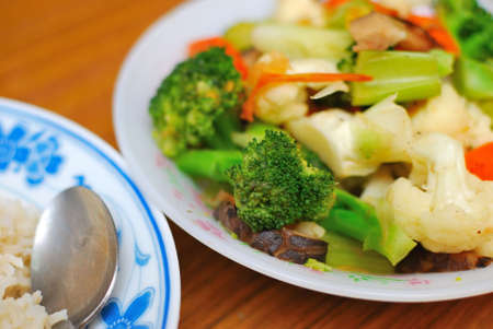 sumptuous: Sumptuous, home cooked Chinese vegetarian cuisine. Ingredients include green and white cauliflower, mushrooms, and carrots. Suitable for food and beverage, healthy lifestyle, and diet and nutrition.