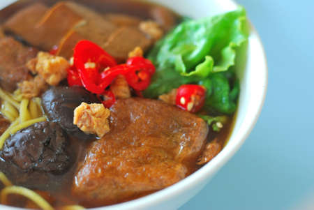 Sumptuous looking Chinese style vegetarian soup noodles with mushrooms and bean curd. Suitable for concepts such as diet and nutrition, healthy eating and healthy lifestyle, and food and beverage. photo
