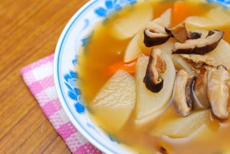 sumptuous: Sumptuous looking Chinese style broth with mushrooms and radishes. Suitable for concepts such as diet and nutrition, healthy eating and healthy lifestyle, and food and beverage.