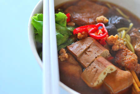 sumptuous: Sumptuous looking Chinese style vegetarian soup noodles with mushrooms and bean curd. Suitable for concepts such as diet and nutrition, healthy eating and healthy lifestyle, and food and beverage.