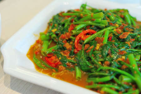 sumptuous: Sumptuous, Chinese style kang kong vegetables cooked with hot, spicy sambal chili sauce. Suitable for food and beverage, travel, healthy lifestyle, and diet and nutrition.