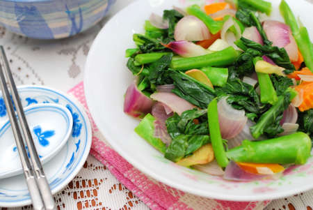 sumptuous: Sumptuous, Chinese vegetarian cuisine. Ingredients include green, leafy vegetables, mushrooms, carrots, and slices of ginger. Suitable for food and beverage, travel, healthy lifestyle, and diet and nutrition. Stock Photo