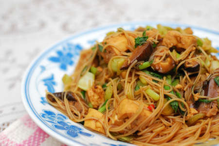 sumptuous: Sumptuous Chinese style vegetarian bee hoon with mixed vegetables and mushrooms. Suitable for concepts such as diet and nutrition, healthy eating and lifestyle, and food and beverage.
