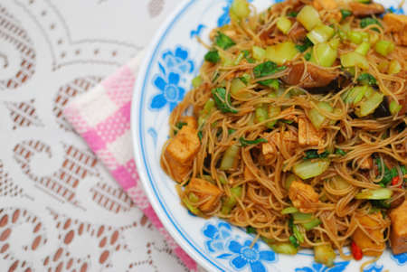 Sumptuous Chinese style vegetarian bee hoon with mixed vegetables and mushrooms. Suitable for concepts such as diet and nutrition, healthy eating and lifestyle, and food and beverage.