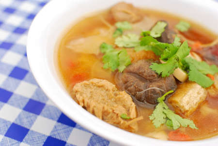 sumptuous: Sumptuous looking Chinese style broth with mushrooms,mock meat and radishes. Suitable for concepts such as diet and nutrition, healthy eating and healthy lifestyle, and food and beverage.