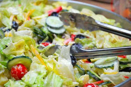 sumptuous: Sumptuous looking vegetarian salad made with a variety of vegetables such as tomatoes, lettuce, peppers, and cucumbers. Suitable for diet and nutrition, healthy lifestyle, and food and beverage.