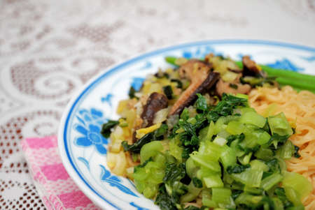 sumptuous: Sumptuous looking Chinese style vegetarian yellow noodles with juicy mushrooms and vegetables. Suitable for concepts such as diet and nutrition, healthy eating and healthy lifestyle, and food and beverage.