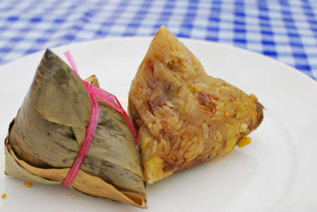 Chinese vegetarian dumpling made from glutinous rice, mock meat, mushrooms and chestnut wrapped in bamboo leaf. Suitable for concepts such as healthy lifestyle, and food and beverage.