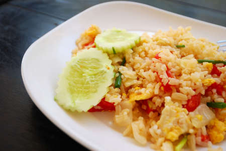 Healthy Thai style vegetarian pineapple fried rice. Suitable for concepts such as diet and nutrition, healthy lifestyle, and food and beverage. Stock Photo