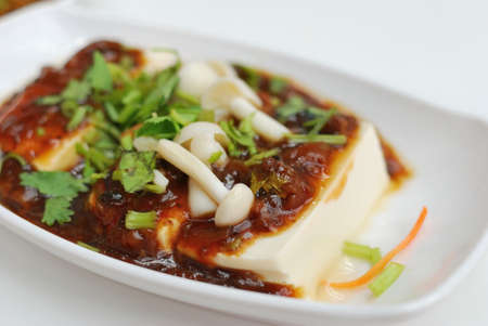 tofu: Chinese vegetarian bean curd cuisine. Ingredients include bean curd and mushrooms. Suitable for food and beverage, healthy eating and lifestyle, and diet and nutrition.