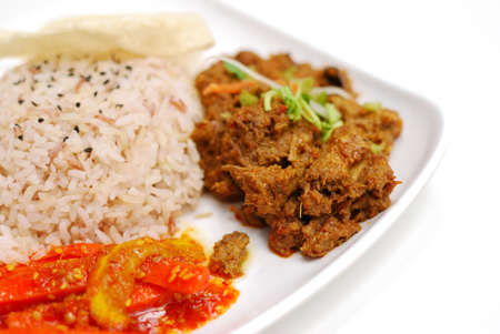 Vegetarian rendang chicken or mutton with unpolished red rice. Suitable for concepts such as diet and nutrition, healthy lifestyle, and food and beverage. Stock Photo