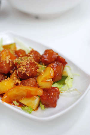 Chinese vegetarian sweet and sour pork cuisine. Ingredients include deep fried mock meat and peppers. Suitable for food and beverage, healthy lifestyle, and diet and nutrition. Stock Photo