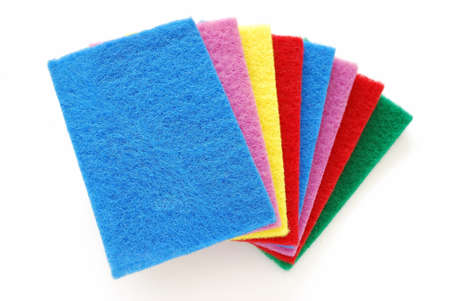 cleaning equipment: Colorful sponges used for cleaning and washing isolated on white background. For cleaning equipment and supplies.