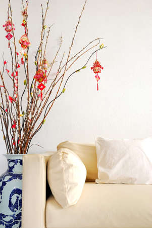 Chinese Lunar New Year decoration with modern sofa. For New Year objects, celebration and festival, and culture and lifestyle concepts. photo