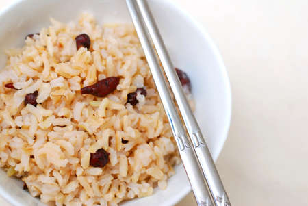 unpolished: Cooked, red unpolished rice commonly eaten in Asian countries such as Japan and China. For diet and nutrition, healthy eating and lifestyle concepts.