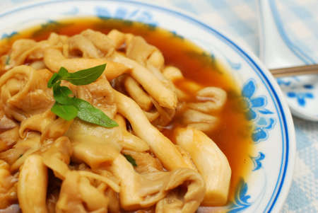 Delicious and healthy Chinese oyster mushrooms with thick gravy. Suitable for concepts such as diet and nutrition, healthy lifestyle, and food and beverage.