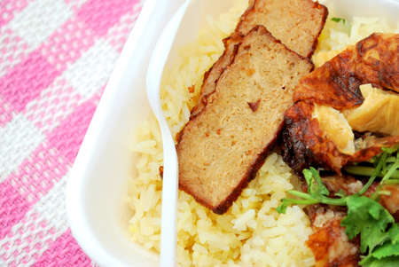 Spoon on delicious roasted pork rice. Suitable for concepts such as diet and nutrition, healthy eating and healthy lifestyle, and food and beverage. photo
