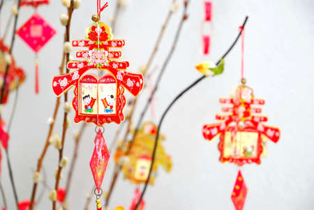 Chinese Lunar New Year decoration on tree signifying the spring season. For New Year objects, celebration and festival, and culture and lifestyle concepts. Stock Photo