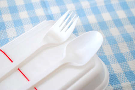 Packed meal in white container with fork and spoon. Suitable for concepts such as diet and nutrition, busy work life, and food and beverage. photo