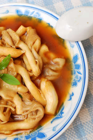 Delicious and healthy Chinese oyster mushrooms with thick gravy. Suitable for concepts such as diet and nutrition, healthy lifestyle, and food and beverage. photo