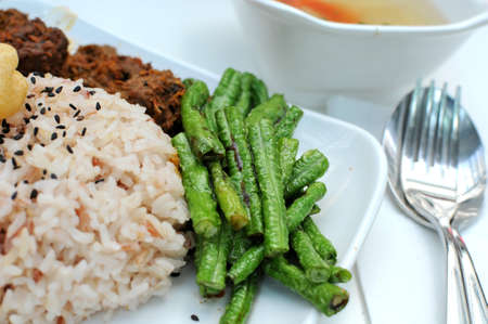 Healthy unpolished red rice and beans. Suitable for concepts such as diet and nutrition, healthy lifestyle, and food and beverage. photo