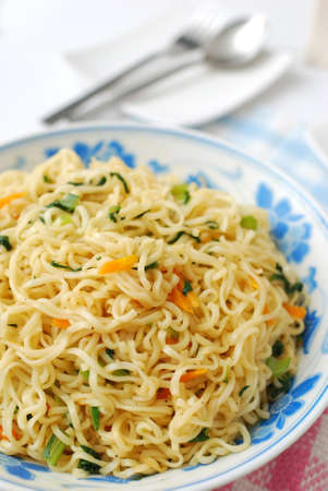 Close shot of huge serving of Chinese vegetarian noodles cooked with healthy vegetables. Suitable for concepts such as diet and slimming, healthy lifestyle, and food and beverage. photo