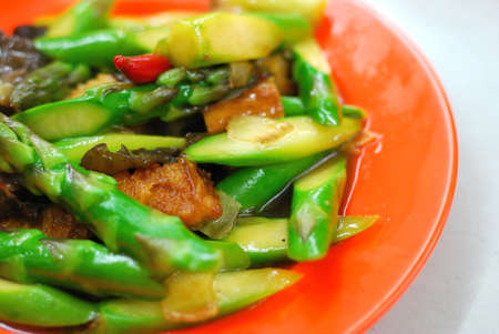 Asian stir fried asparagus cooked with various vegetable ingredients. Suitable for food and beverage, healthy lifestyle, and diet and nutrition.