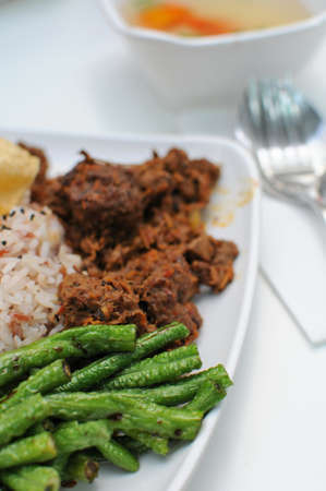 Vegetarian rendang chicken or mutton with unpolished red rice. Suitable for concepts such as diet and nutrition, healthy lifestyle, and food and beverage. photo