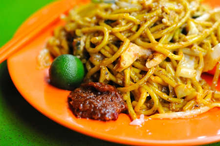 mee: Spicy Malay style fried noodles. Made with various ingredients and vegetables. For concepts such as healthy eating and lifestyle, and food and beverage. Stock Photo