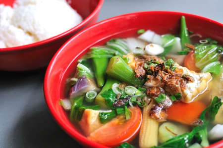 Chinese vegetable soup consisting of mixed vegetables and rice. Suitable for concepts such as diet and nutrition, healthy eating and lifestyle, and food and beverage.