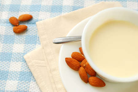 Top view of nutritious almond drink with almond seeds. Almond is used in Chinese desserts and cuisine. For food and beverage, and diet and nutrition concepts.