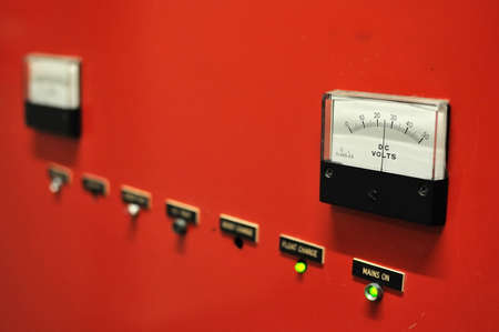 electricity meter: Red electricity meter showing voltage. For concepts such as electricity, energy, and industrial concepts.