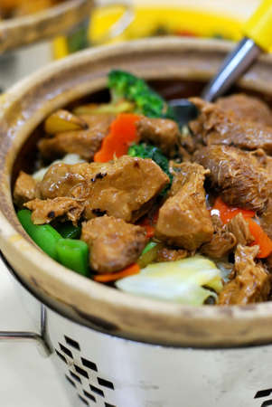 delicacy: Delicious Chinese vegetarian claypot delicacy known as monkey head mushrooms. Suitable for concepts such as diet and nutrition, healthy eating lifestyle, and food and beverage. Stock Photo