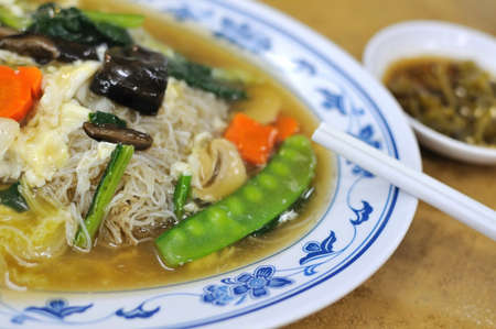 hoon: Vegetarian Asian bee hoon with healthy vegetables. Suitable for concepts such as diet and nutrition, healthy lifestyle, and food and beverage.