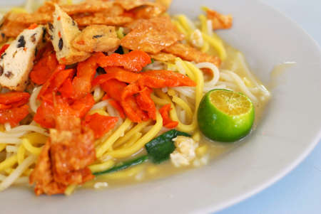 Singapore local delicacy of fried noodles. Suitable for concepts such as diet and nutrition, healthy lifestyle, and food and beverage. photo