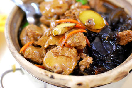 Delicious Chinese vegetarian claypot delicacy known as monkey head mushrooms. Suitable for concepts such as diet and nutrition, healthy eating lifestyle, and food and beverage. Stock Photo