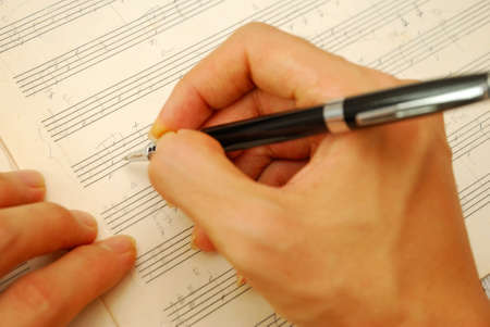 점수: Composing music on old manuscript. For concepts like music composition, and ideas and creativity.