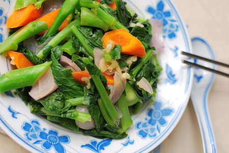 Simple green leafy vegetables from the cooked Chinese style. For concepts such as food and beverage, diet and nutrition, and healthy eating. Stockfoto - 7677687