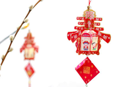 Chinese Lunar New Year decoration isolated on white background signifying the spring season. For New Year objects, celebration and festival, and culture and lifestyle concepts. Stock Photo - 7775678