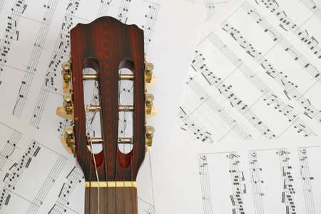 Guitar with music scores in background. For concepts like music and creativity. photo