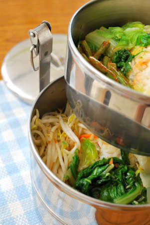 Takeout meals in metal containers. For concepts such as diet and nutrition, busy work life, and food and beverage. photo