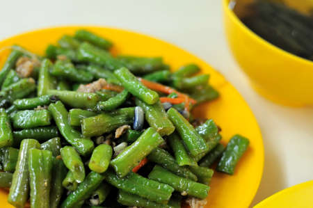 Healthy vegetarian dish of long beans. Suitable for concepts such as diet and nutrition, healthy lifestyle, and food and beverage. photo