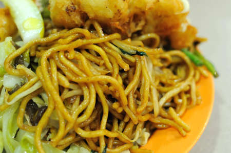 Spicy Malay style fried noodles. Made with various ingredients and vegetables. For concepts such as healthy eating and lifestyle, and food and beverage. photo