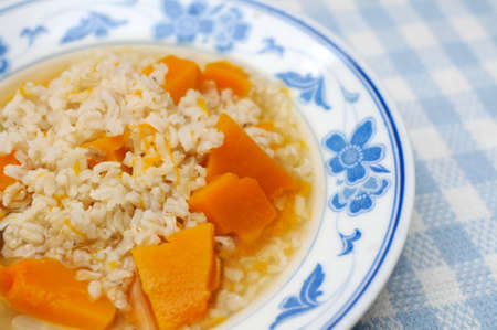Simple and healthy porridge cooked with sweet potato. For diet and nutrition, healthy eating and lifestyle concepts. Stock Photo